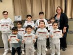 students with Student of the Month certificates